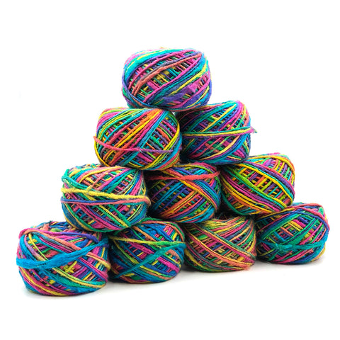 10 cakes of multicolored yarn stacked on a white background