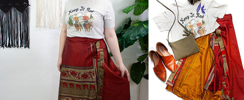 western graphic t-shirt with red sari wrap skirt styled with brown shoes and an olive bag
