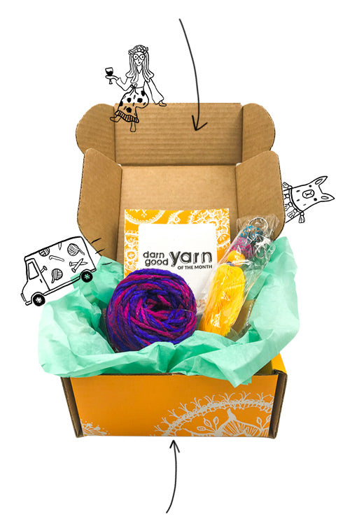 A photo of an open Yarn of the Month subscription box with product contents inside.
