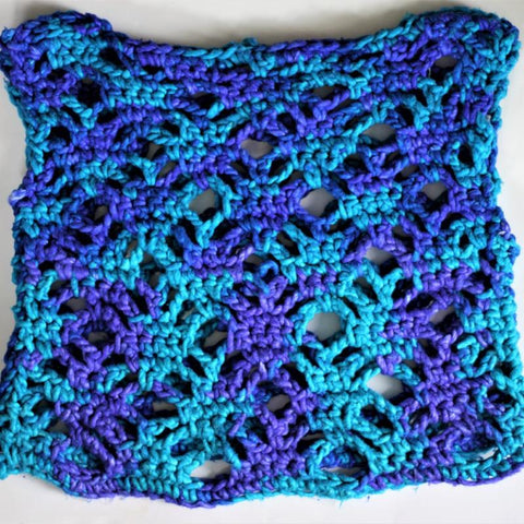 Close up of a blue mermaid splash summer crochet top  on a white background