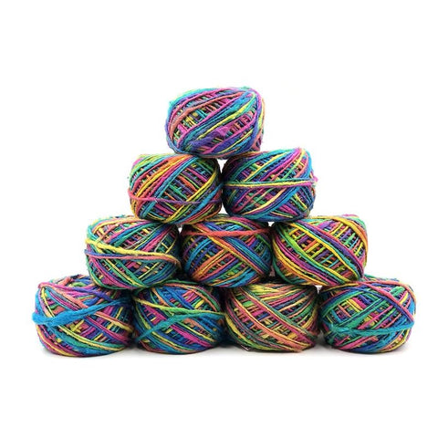 10 balls of multicolored yarn stacked on a white background