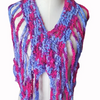 Purple and pink crocheted top on a white mannequin on a white background