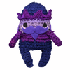 Purple amigurumi nutcracker made of silk chiffon on a white background