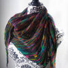 Black and rainbow shawl on a mannequin on a white background