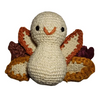 White amigurumi turkey with yellow, orange and brown feather tips on a white background