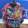 Sparkle Me Shawl Kit in multicolors on a mannequin in front of a blue wall