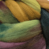 close up of yarn in the color arco iris (green, yellow, and pink)