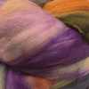 close up of yarn in the color diana (purple, white, and orange)
