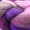 close up of yarn in the color sabiduria (pink and purple)