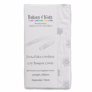 Embroidered Snowflake Cordless Cot Bumper Cover in packaging