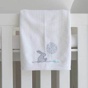 Bunny Hop Cellular Cotton Baby Blanket (white) in cot