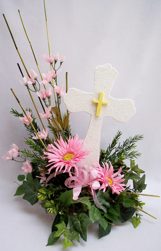 Pink cross centerpiece with white & pink lilies & other cross centerpieces