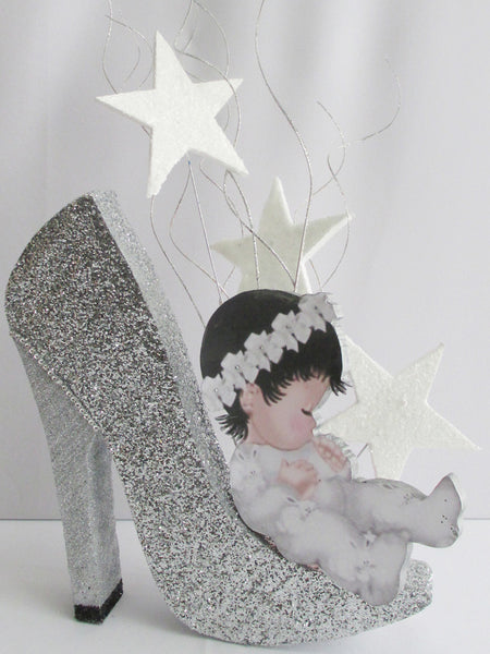 Baby on high heeled shoe centerpiece