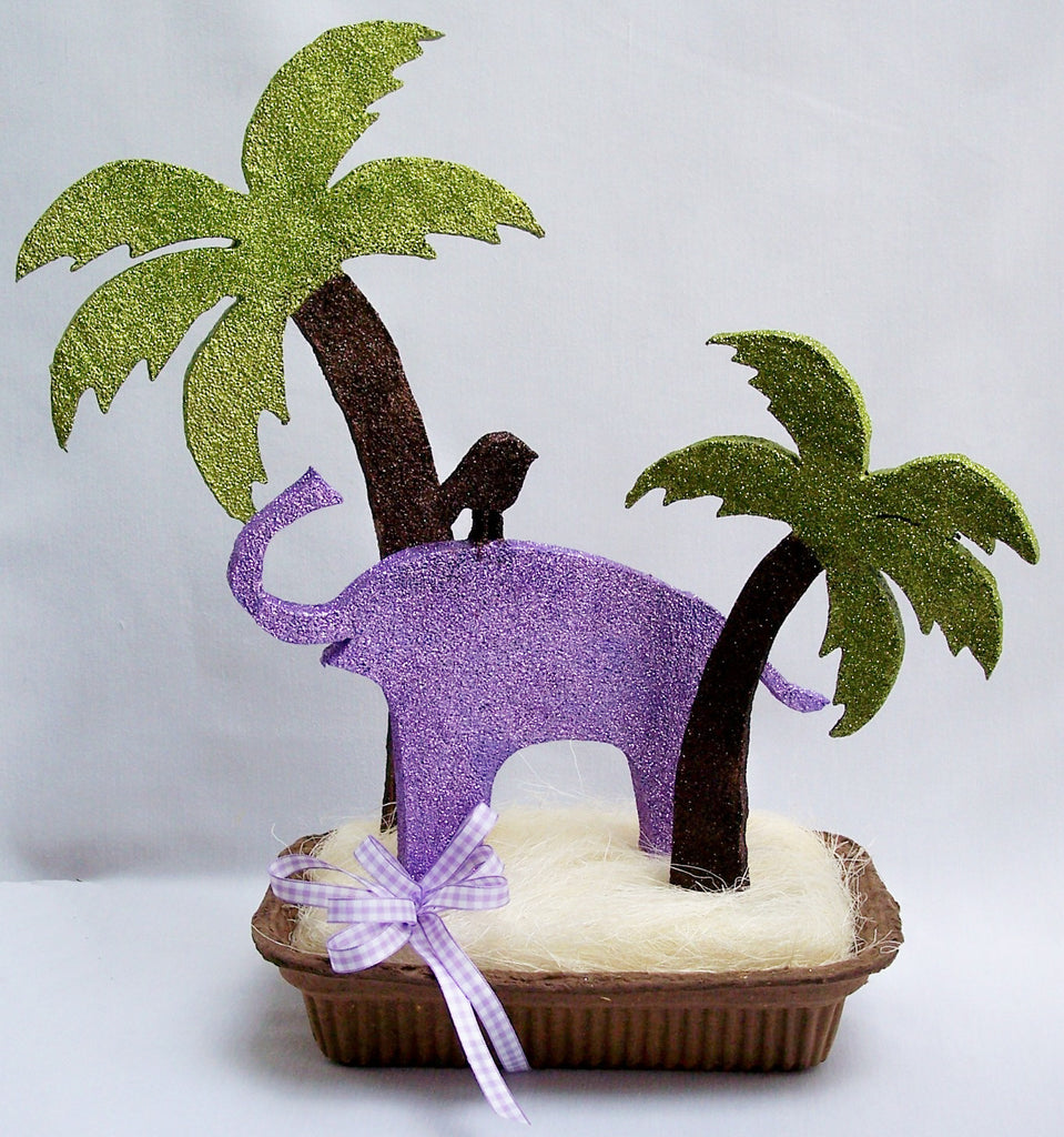 Baby shower centerpieces with butterflies, elephant, palm trees,baby silhouttes,flowers etc.