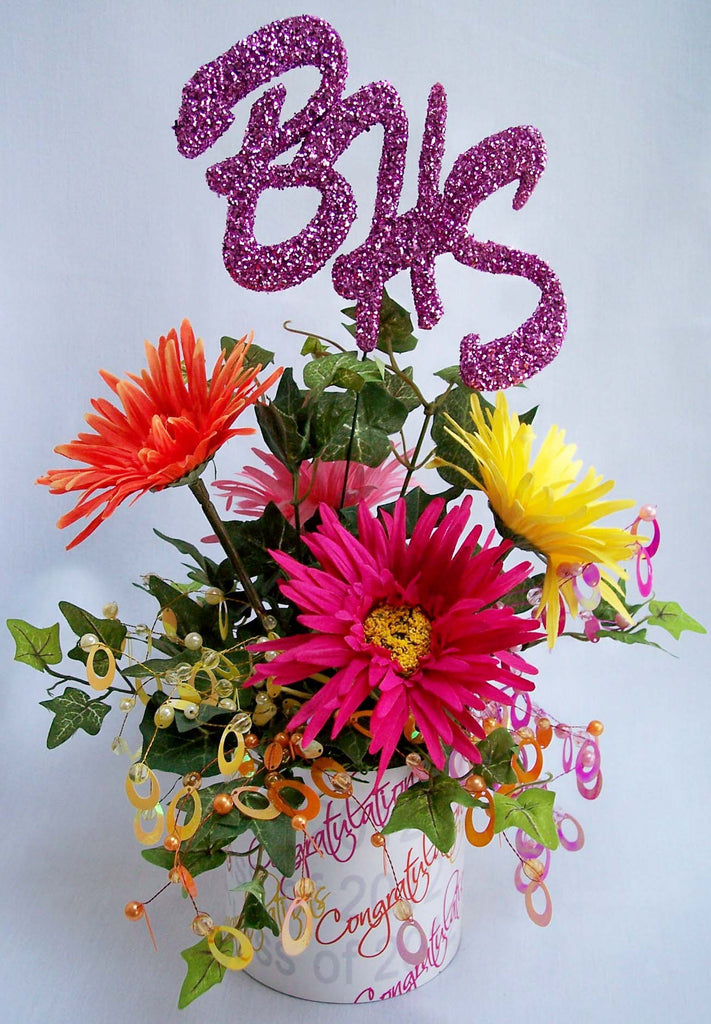 Colorful graduation centerpiece with daisies and school initials