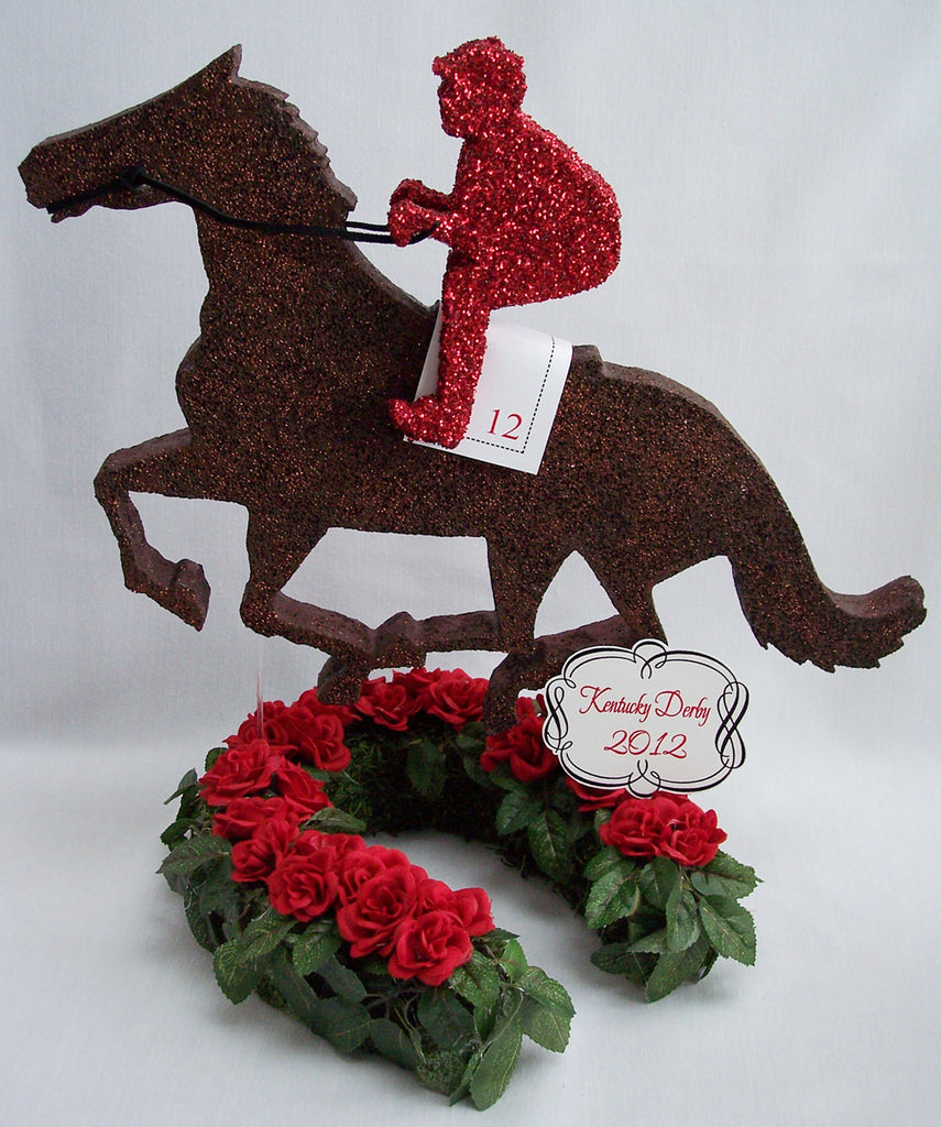 Kentucky Derby themed centerpieces with horse, jockey, trophy & roses.