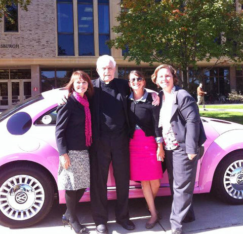 Linda and Fr. Hesburgh and volkswagen car - Designs by Ginny
