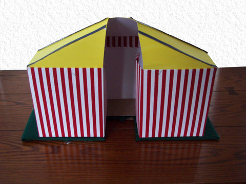 We used red and white stripe fabric for the tent and painted the roof yellow. We added stripes of blue paper to create dimension on the roof. & Circus Tent Centerpiece u2013 Designs by Ginny