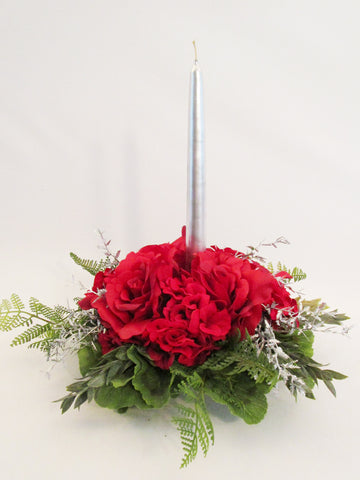 red roses and geraniums with candle centerpiece