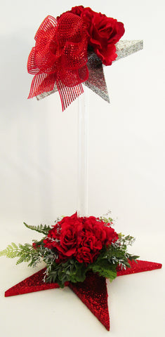 red roses and geraniums with red star base and topper centerpiece - Designs by Ginny