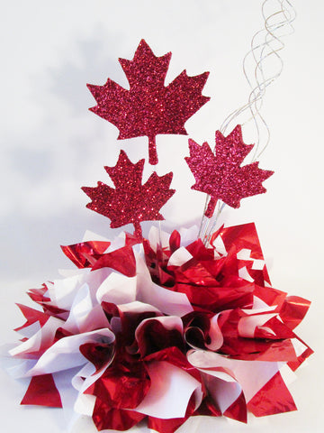 Canadian maple leaf cutouts on metallic tissue base centerpiece