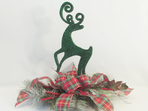 Styrofoam reindeer on plaid bow and greenery centerpiece - Designs by Ginny