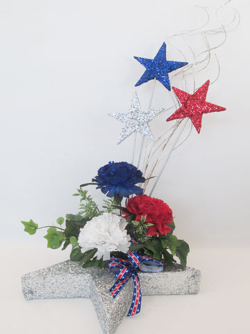 Patriotic stars, red,white & blue flowers centerpiece - Designs by Ginny