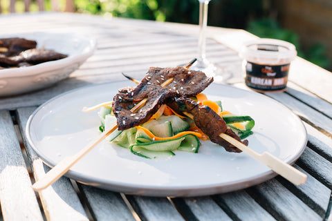 Korean BBQ steak skewers with pickled ribbon salad