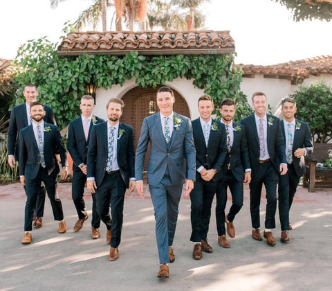 a unique groom suit compared to groomsment