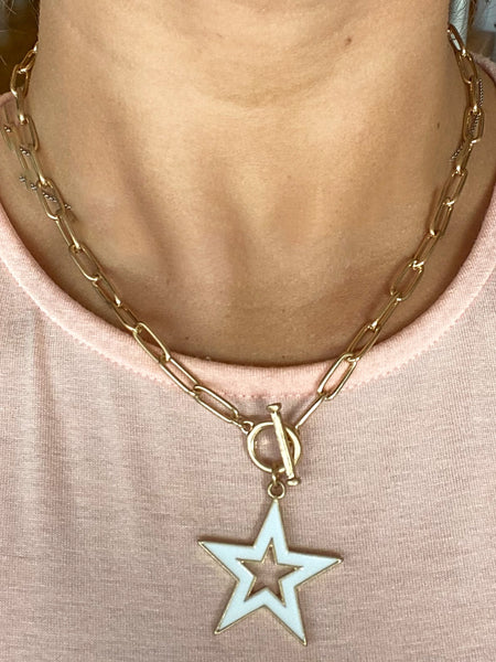 white star necklace on