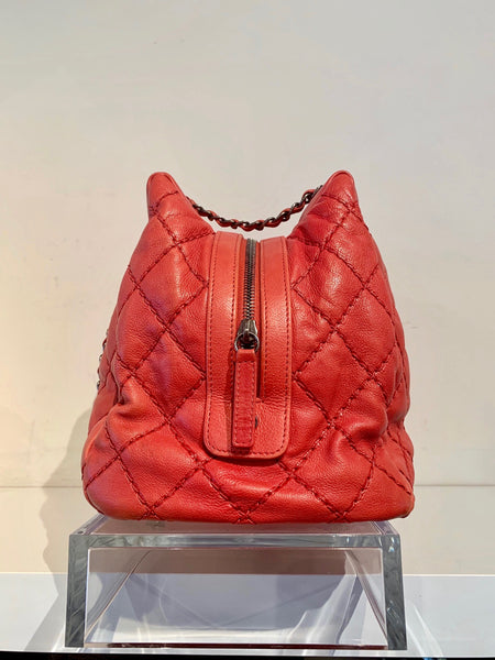 Chanel Quilted Bowler Bag Red Side of Bag
