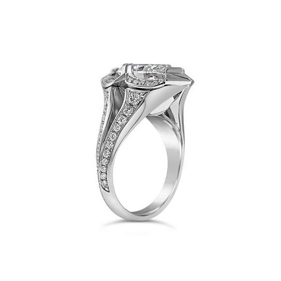 Marquise and round diamond ring in 18k white gold