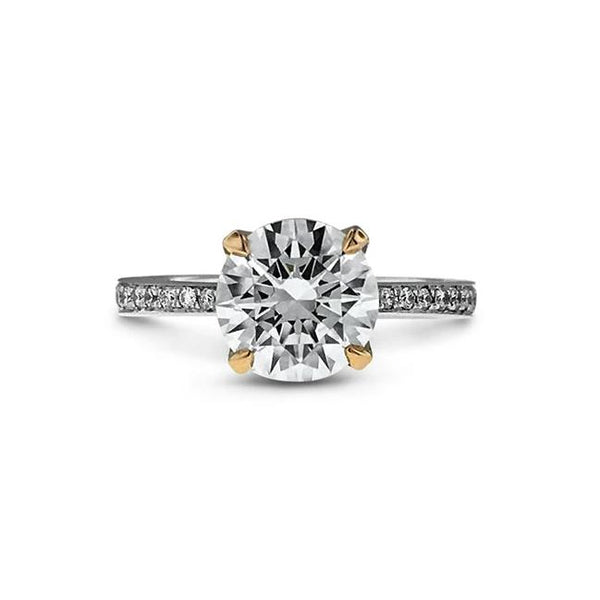 Round diamond ring in 18k mixed metal