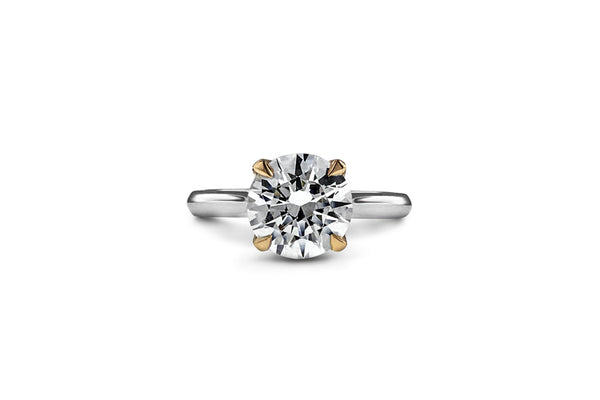 Round diamond solitaire ring in 18k mixed metal