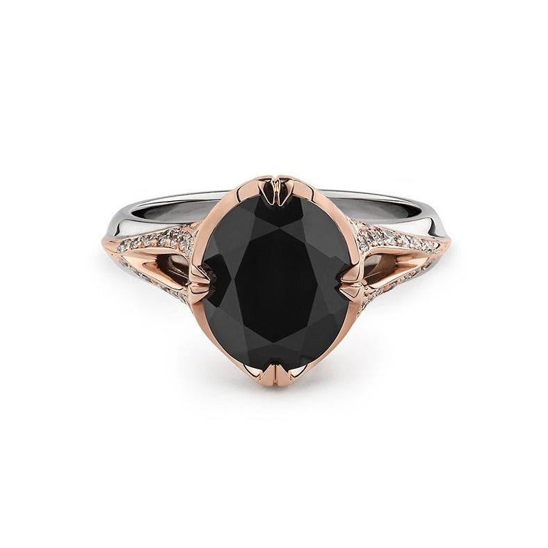 Black spinel and diamond ring in 18k mixed metal