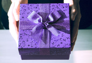 Woman Holding Purple Gift Box With Bow