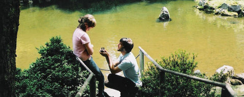 Man Proposing To Woman Next To Creek