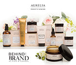Behind the Brand - Up Close and Personal: A selection of Aurelia Probiotic Skincare products and boxes with flowers in the background