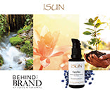 Behind the Brand - Up Close and Personal: Beauty shots of stream, flower and small plant with dirt in palms of woman's hands, ISUN's Sapphire Facial Oil Moisturizer with cluster of small sapphires in the background