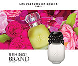 Behind the Brand - Up Close and Personal: A selection of Les Parfums de Rosine fragrances with pink roses in the background