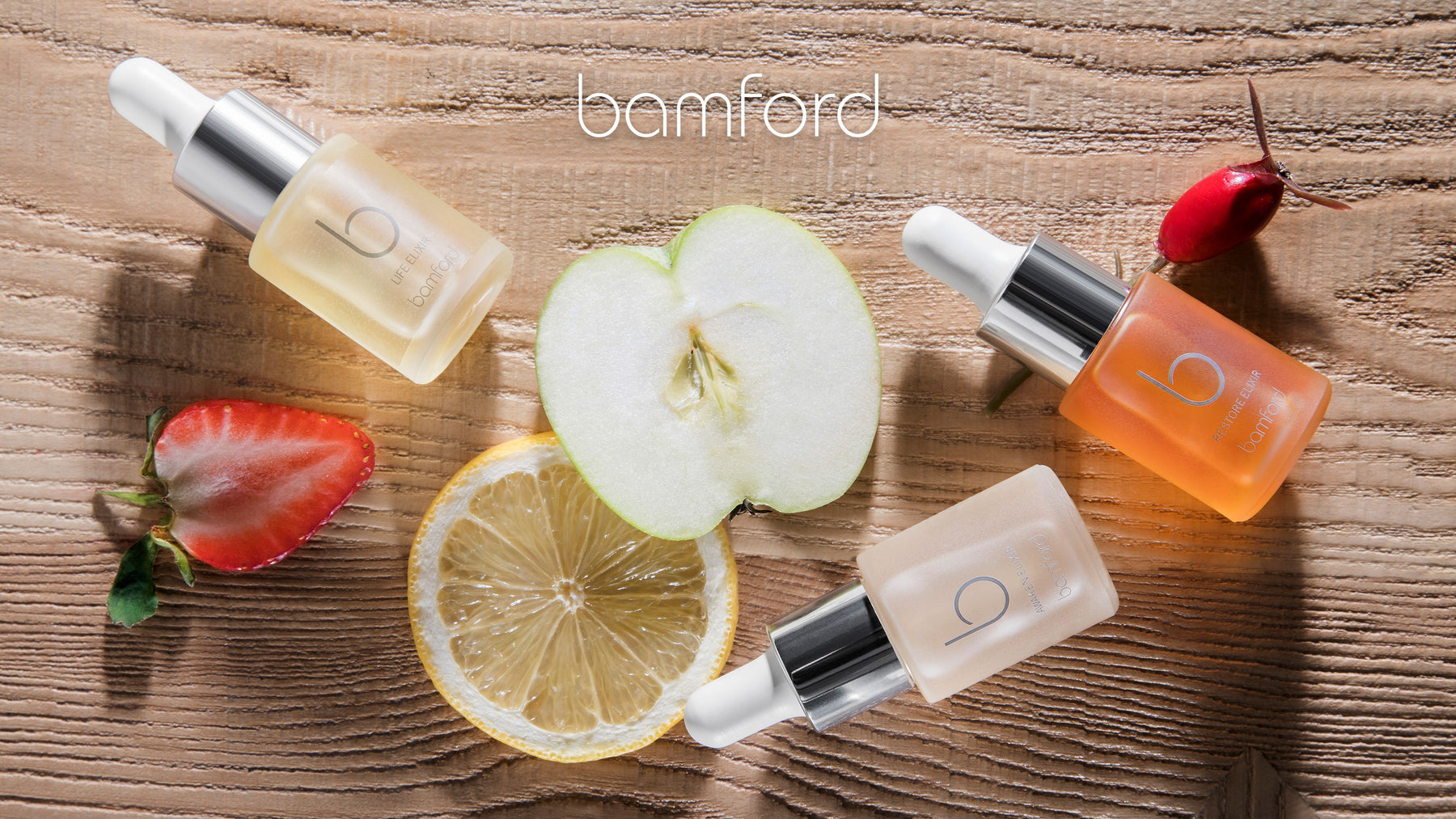 A selection of Bamford Elixirs shown top view on wood with ingredients in the background