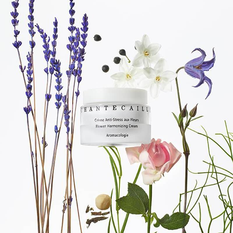 Beauty shot of Chantecaille Flower Harmonizing Cream (50 ml) with various flowers in the background