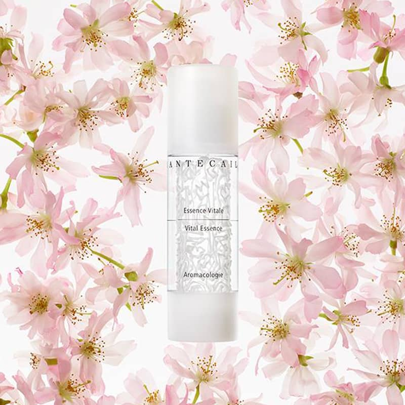 Beauty shot of Chantecaille Vital Essence 50 ml with flowers in the background
