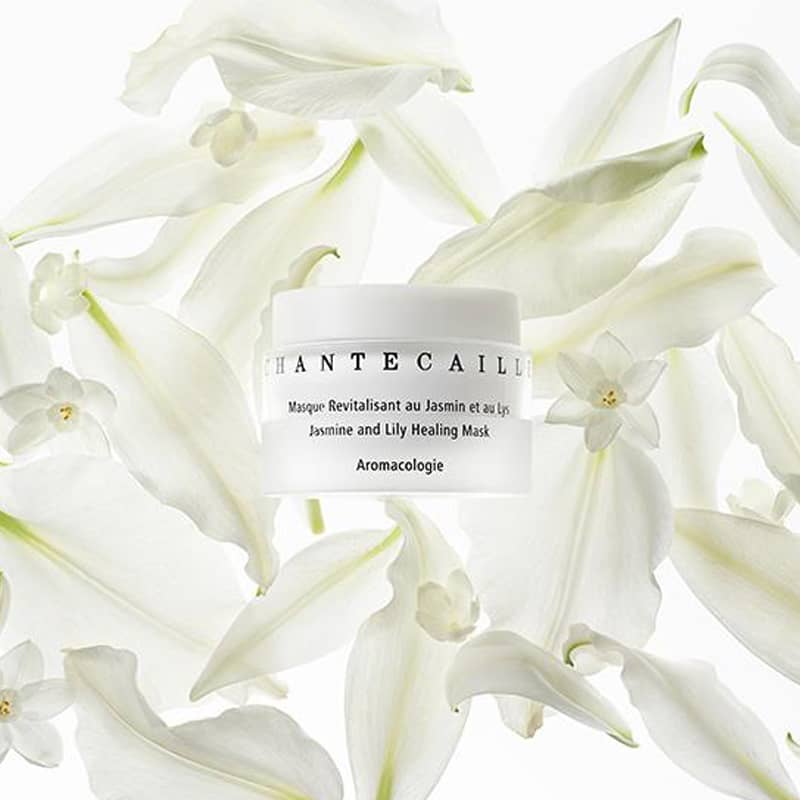 Beauty shot top view of Chantecaille Jasmine & Lily Healing Mask 50 ml with jasmine and lily in the background