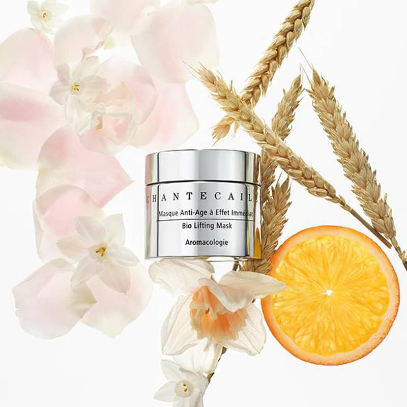 Beautyshot of Chantecaille Bio Lifting Mask 50 ml shown with flowers, wheat and an orange slice