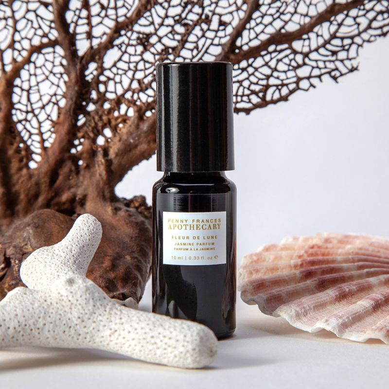 Penny Frances Apothecary Fleur de Lune Jasmine Perfume Oil Beauty Shot with seashell and coral