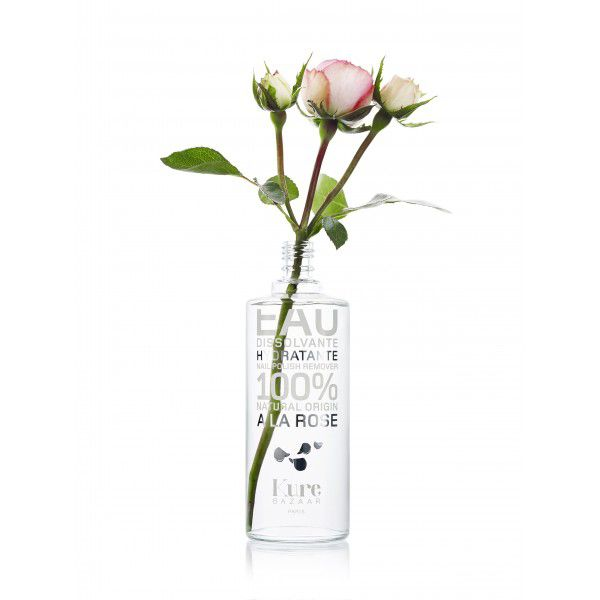 Kure Bazaar Nail Polish Remover - A la Rose - beauty shot with rose in polish remover bottle