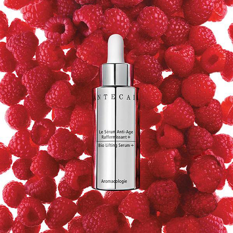 Beauty shot of Chantecaille Bio Lifting Serum Plus with raspberries in the background