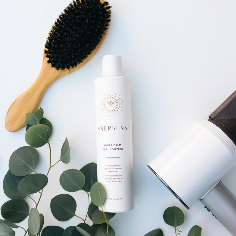 Beauty shot of Innersense Organic Beauty Quiet Calm Curl Control 10 oz with brush and hairdryer (not included with purchase)