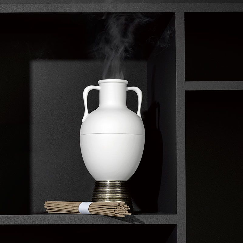 L'Objet Amphora Incense Holder on black shelf